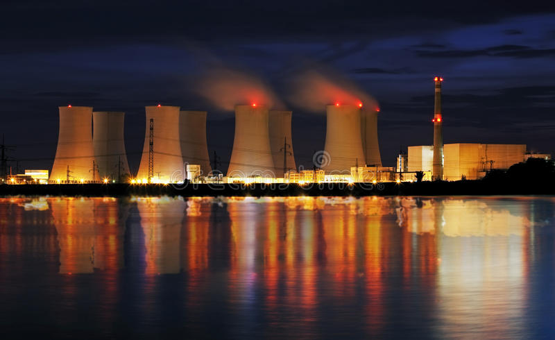 Nuclear power plant by nigh. T with reflection stock photos