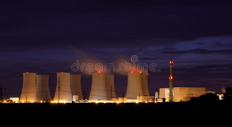 Nuclear power plant by night. Big Nuclear power plant by night royalty free stock image