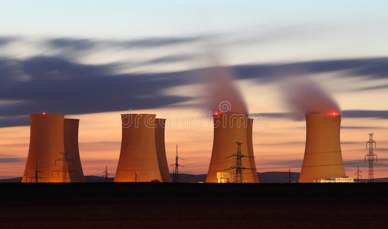 Nuclear power plant orange clouds at night. Nuclear power plant by night stock image
