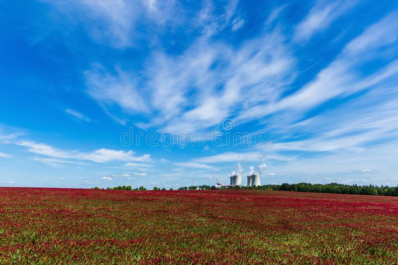 Nuclear power plant Temelin and clover field in Czech Republic. Europe royalty free stock image