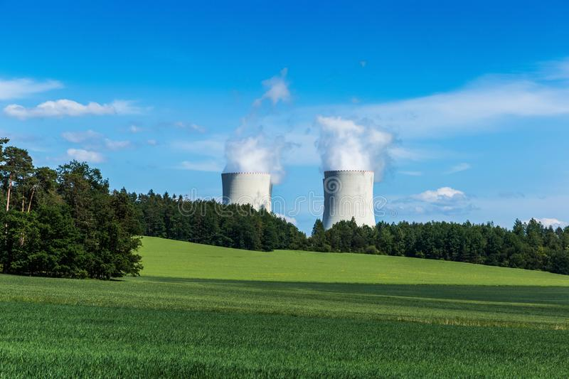 Nuclear power plant Temelin and clover field in Czech Republic. Europe stock photo