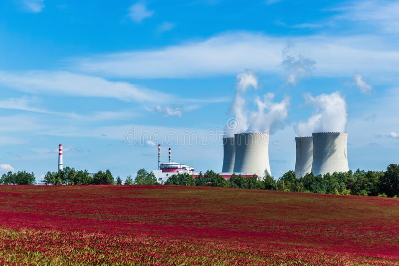 Nuclear power plant Temelin and clover field in Czech Republic. Europe royalty free stock photography
