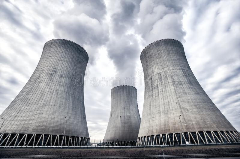 Nuclear power plant in Temelin, Czech Republic, Europe. White smoke coming from the cooling towers of the nuclear power plant in Temelin, Czech Republic, Europe stock images