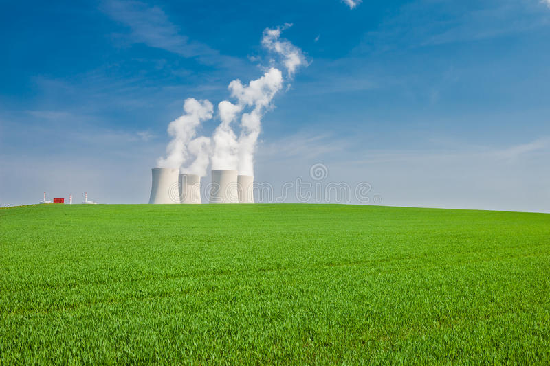 Nuclear Power Plant in Temelin Situated Behind a Green Field. (shot on a sunny spring day royalty free stock images