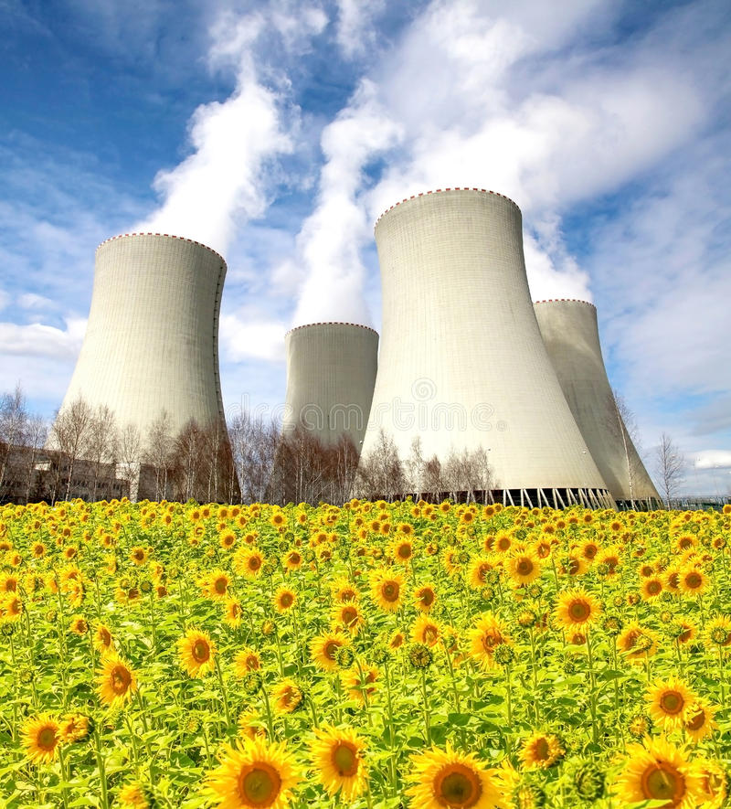 Nuclear power plant Temelin with sunflower field, Czech Republic. Nuclear power plant Temelin with sunflower field and blue sky, Czech Republic stock photography