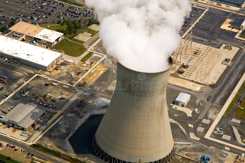 Nuclear power station. An aerial view of the cooling tower and rising steam from a nuclear power plant stock image