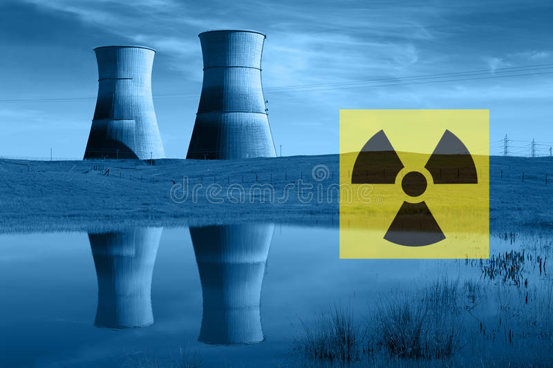 Nuclear Reactor Cooling Towers, Radiation Hazard Symbol Stock Photo