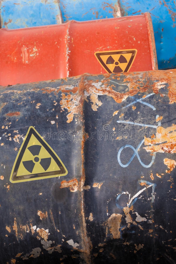 Nuclear Waste. Banged up steel barrels containing radioactive nuclear waste stock photos