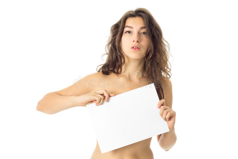 Nude brunette girl with placard. Adorable nude brunette girl with placard isolated on white background stock photo