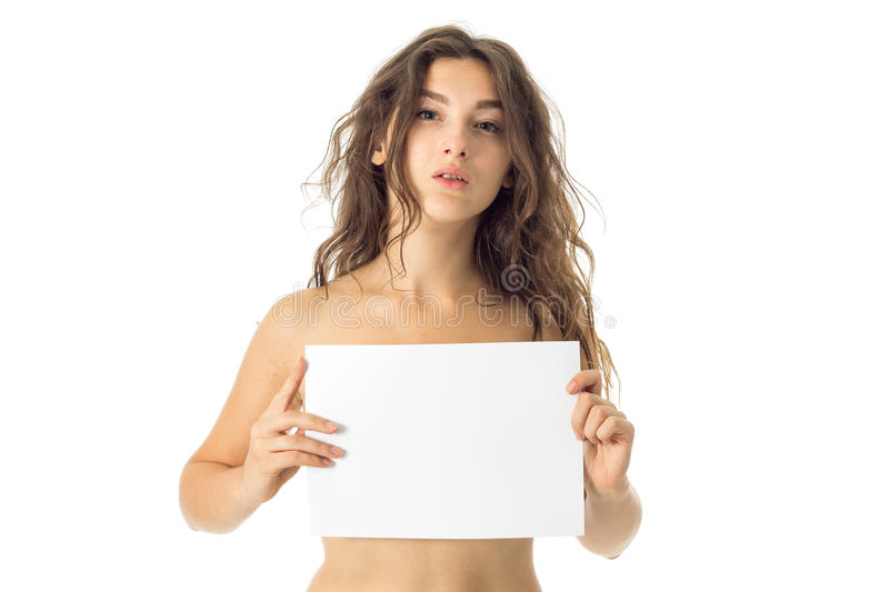 Nude brunette girl with placard. Adorable young nude brunette girl with placard isolated on white background royalty free stock images