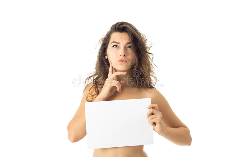 Nude brunette girl with placard. Thoughtful nude brunette girl with placard isolated on white background stock photos