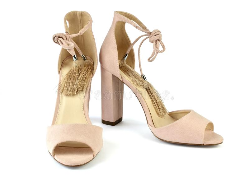 Nude look Roman style sandals. Nude look Roman style high-heeled sandals on white background stock photo