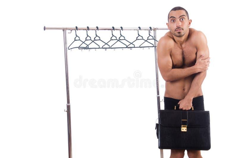 Nude man choosing clothing isolated on white. The nude man choosing clothing isolated on white royalty free stock image