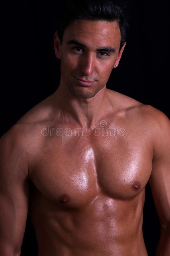 Nude man. Portrait of handsome nude man over dark background stock photo