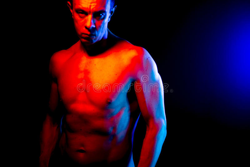 Nude muscular fit man naked. Nude sporty slim attractive muscular fit male model man naked with strong six pack abs, obliques muscles, chest and arms stock photo