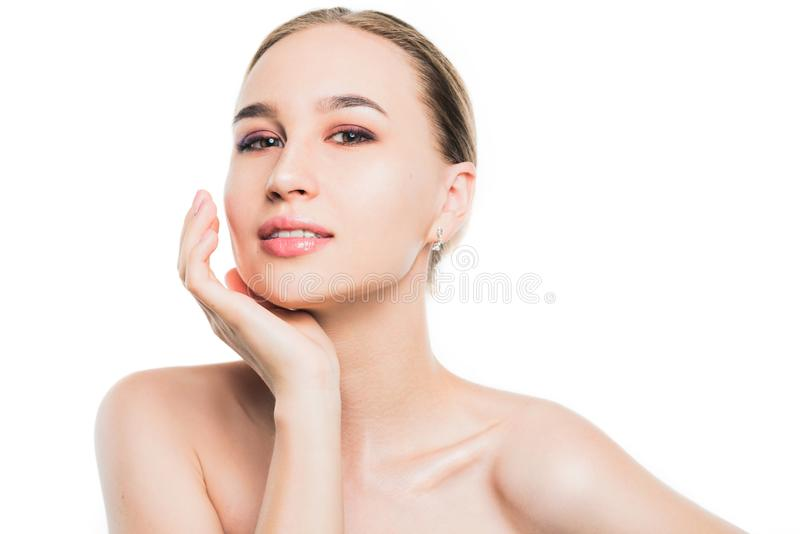 Nude portrait of a beautiful young girl on a white background. cosmetology. royalty free stock photography