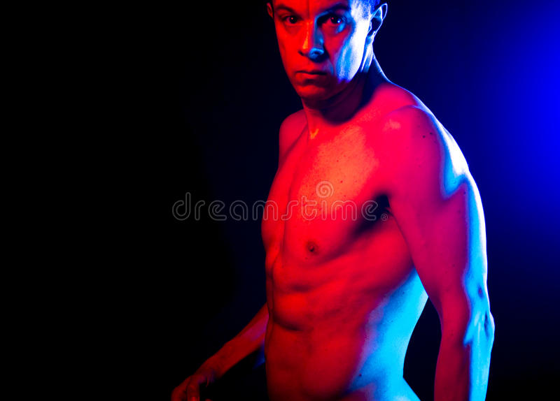 Nude muscular fit man naked. Nude sporty slim attractive muscular fit male model man naked with strong six pack abs, obliques muscles, chest and arms stock images