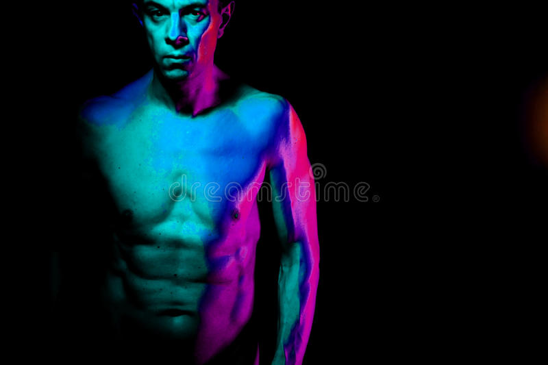 Nude muscular fit man naked. Nude sporty slim attractive muscular fit male model man naked with strong six pack abs, obliques muscles, chest and arms stock photography