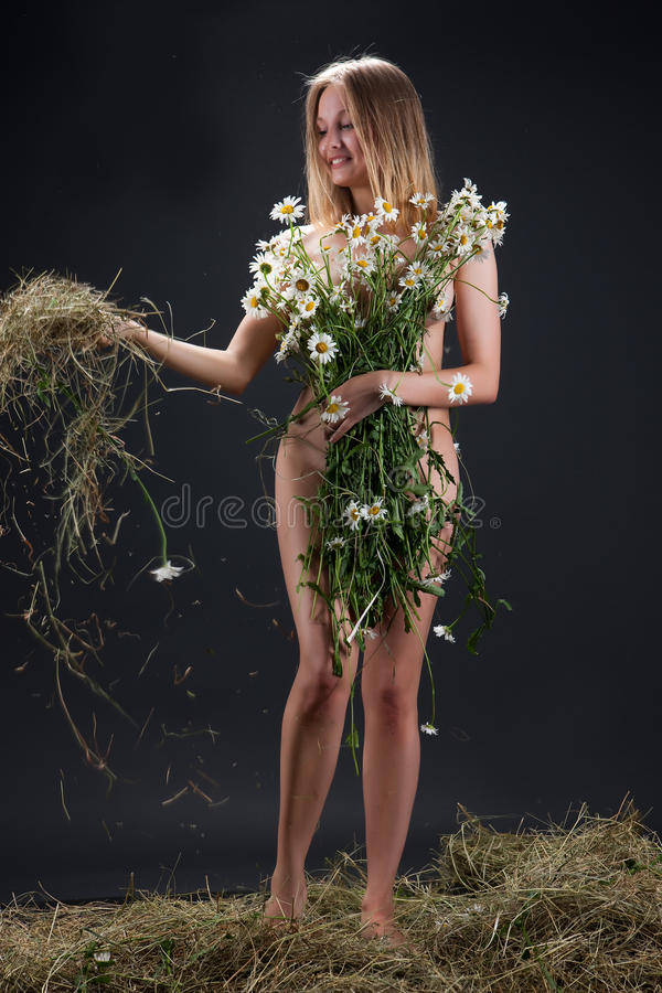 Nude Woman With Camomiles stock photo