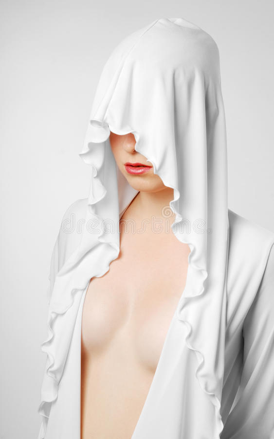 Nude woman closed with white hood royalty free stock image