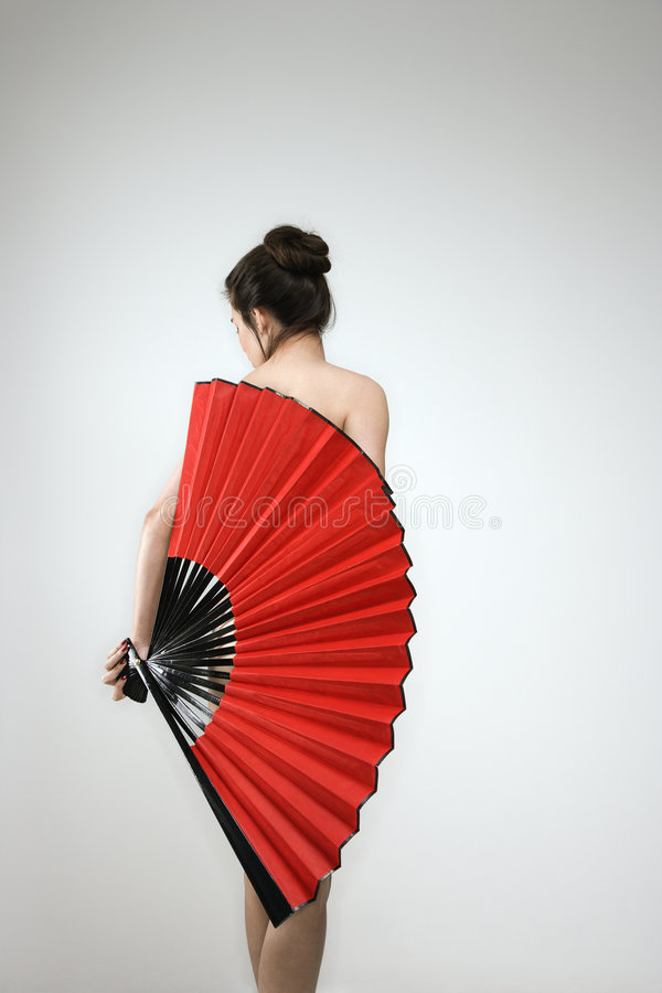 Nude woman with fan. stock photo
