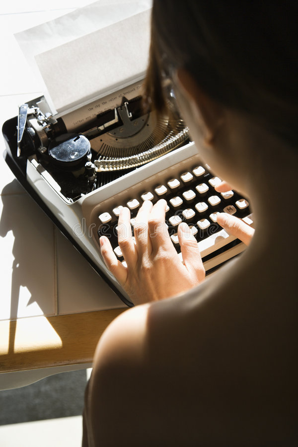 Nude woman typing. stock photography