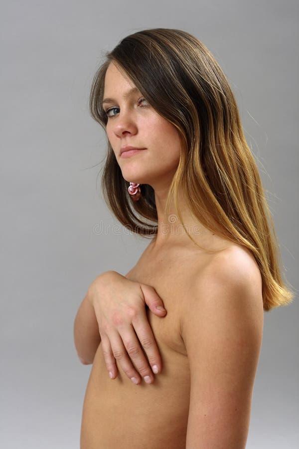 Download Nudité image stock. Image du main, hésite, beau, flirt - 2135749