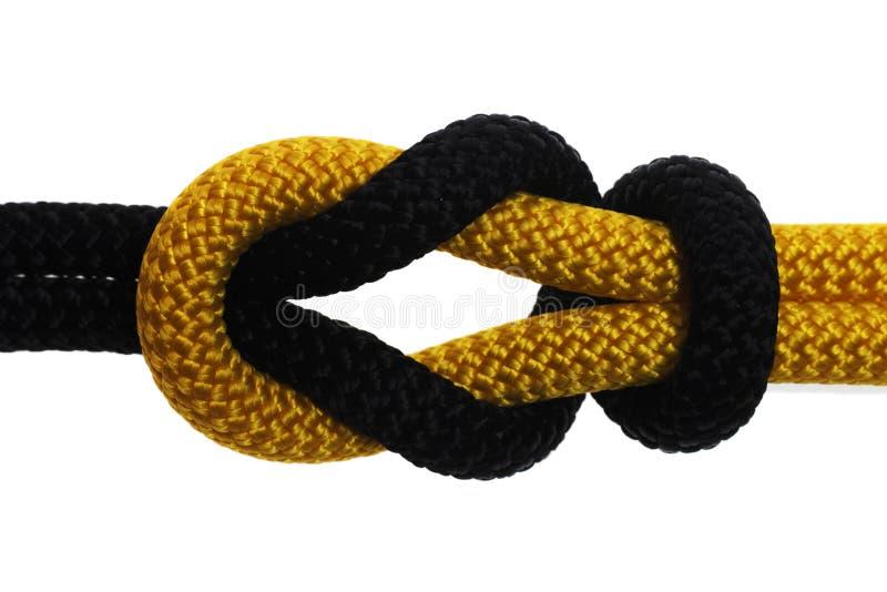 Nudo académico de la cuerda negra y amarilla imágenes de archivo libres de regalías