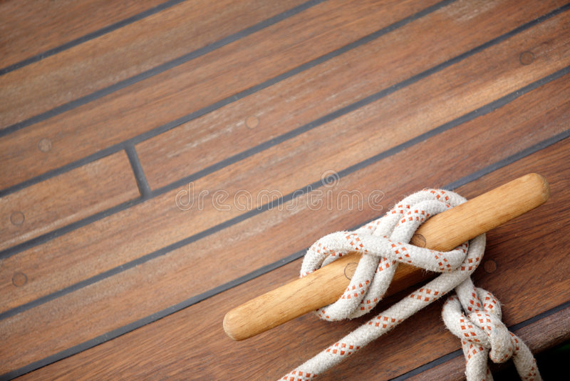 Nudo de la navegación en un suelo de madera imágenes de archivo libres de regalías