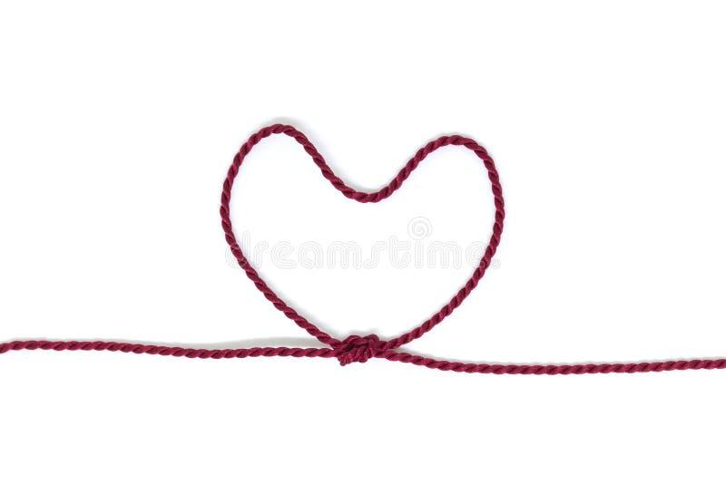 Nudo en forma de corazón en una cuerda foto de archivo libre de regalías