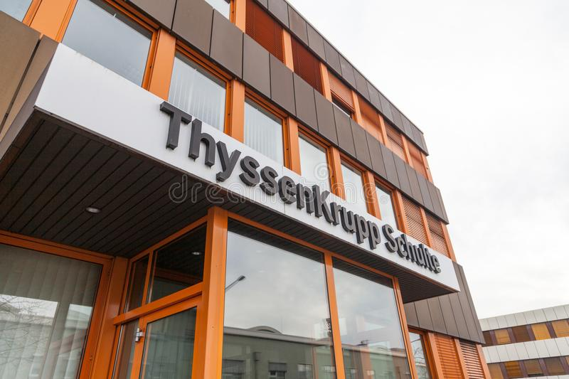 German steel producer ThyssenKrupp logo on entrance building. NUERNBERG / GERMANY - MARCH 4, 2018: German steel producer ThyssenKrupp logo on entrance building royalty free stock photo