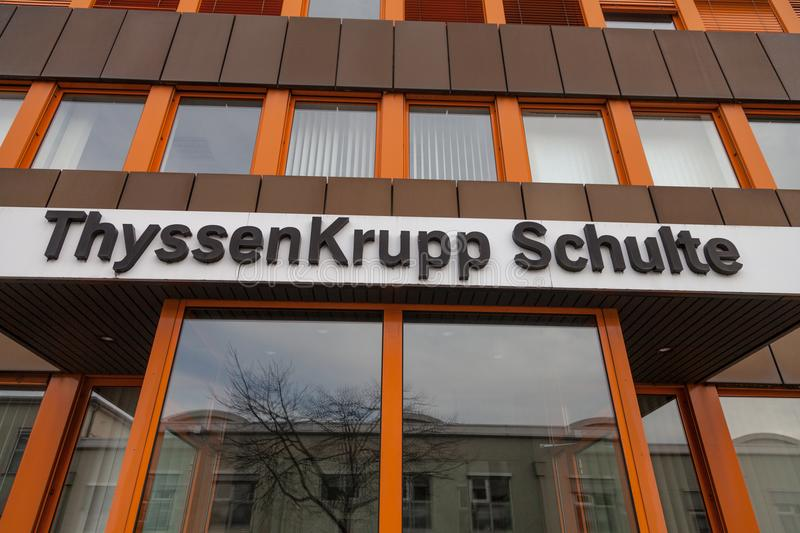 German steel producer ThyssenKrupp logo on entrance building. NUERNBERG / GERMANY - MARCH 4, 2018: German steel producer ThyssenKrupp logo on entrance building stock photo