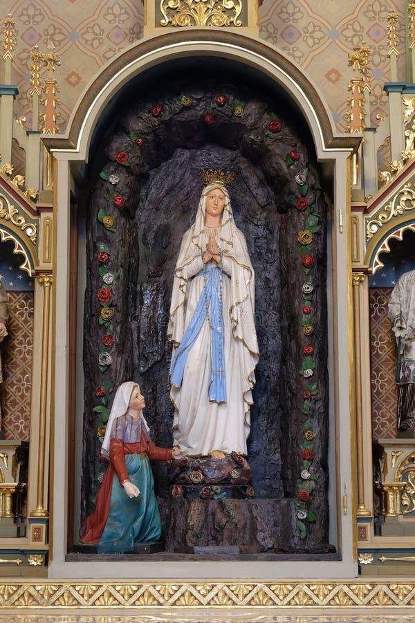 Nuestra señora de Lourdes imagenes de archivo