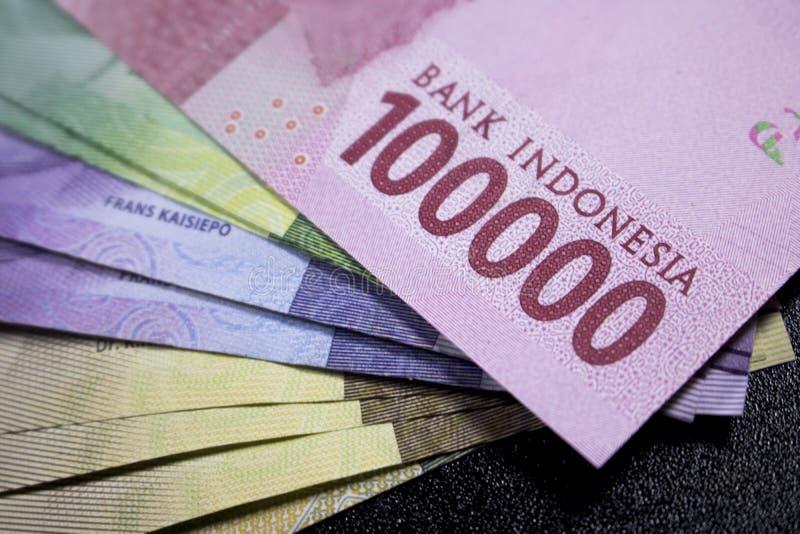 nuevas finanzas del efectivo de la moneda de Indonesia del dinero del rupia fotografía de archivo libre de regalías