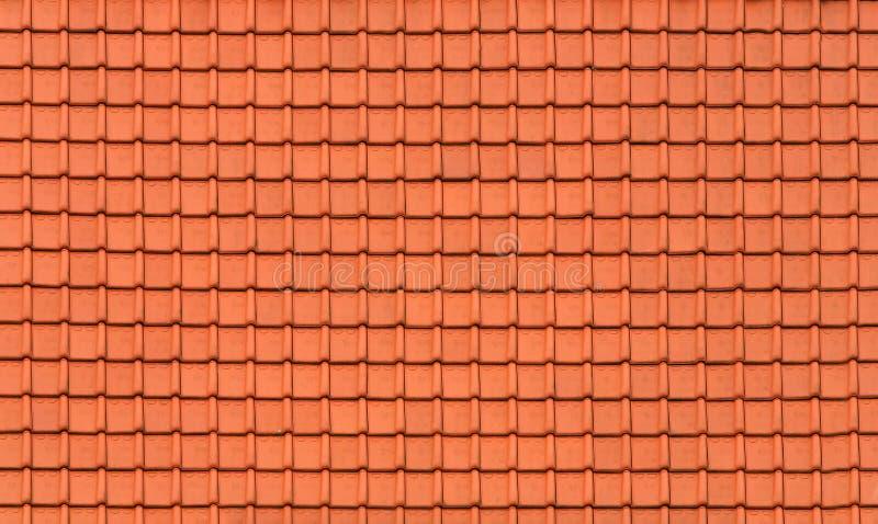 Nuevas tejas anaranjadas en el tejado del edificio foto de archivo libre de regalías