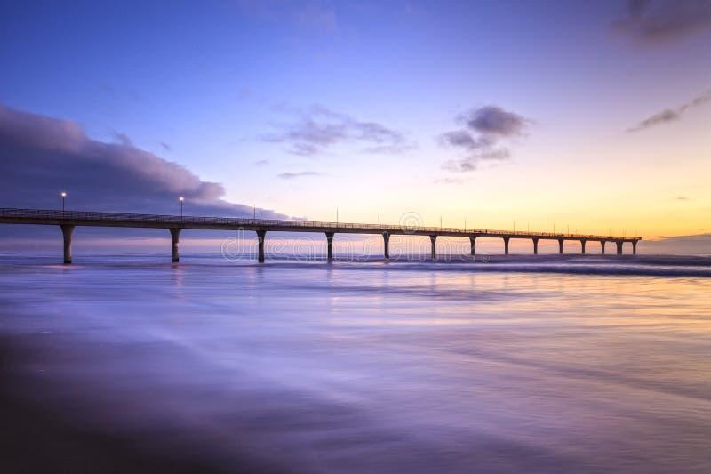Nuevo Brighton Pier, Christchurch, Nueva Zelanda, salida del sol fotografía de archivo libre de regalías