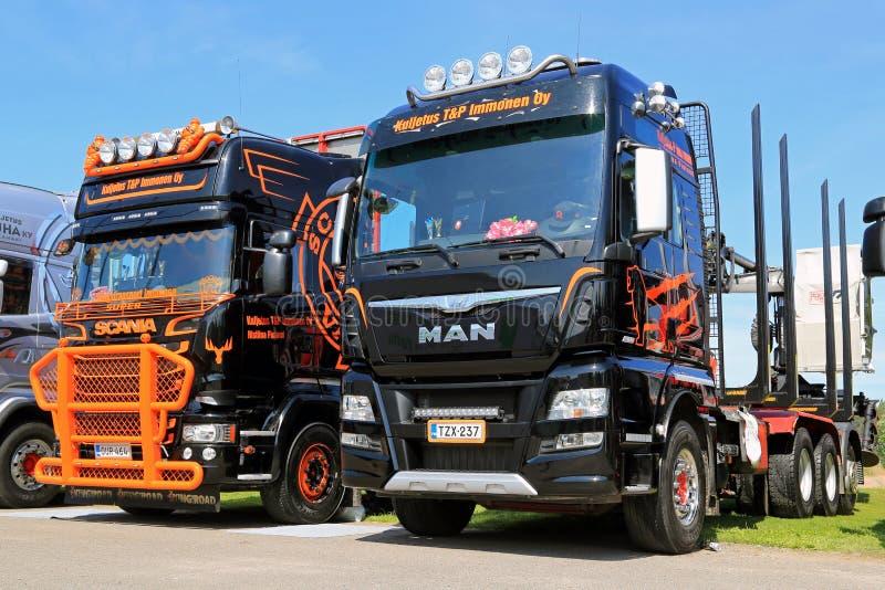 Nuevo HOMBRE y camiones de registración de Scania en una demostración imagen de archivo