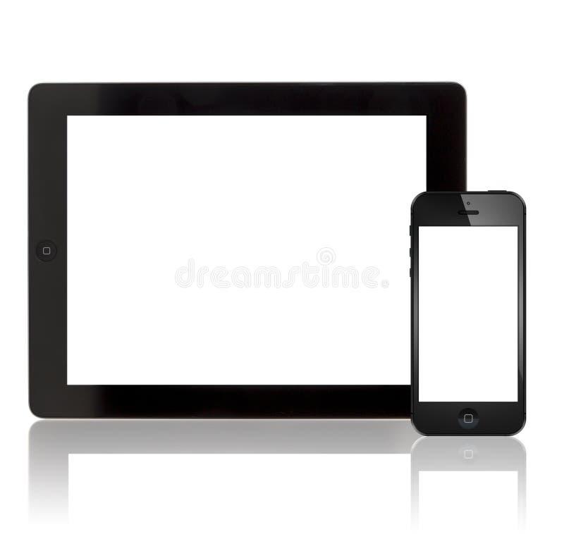 Nuevo iPad 3 de Apple e iPhone 5 foto de archivo libre de regalías