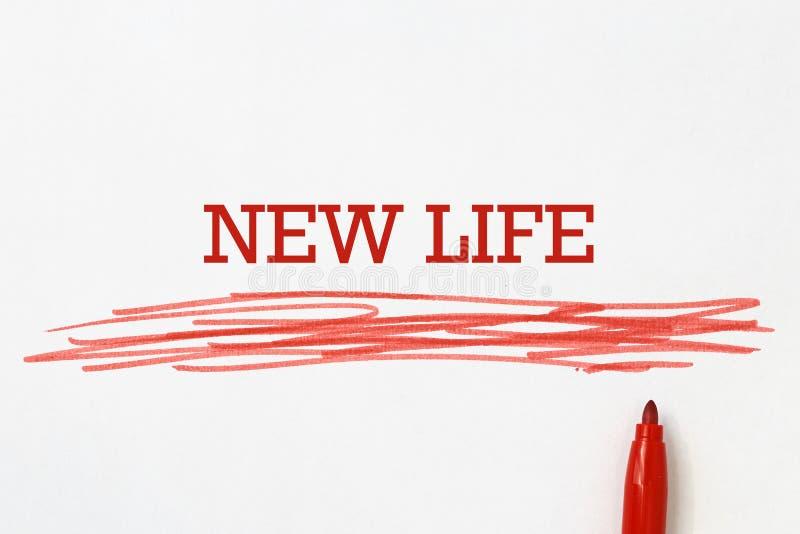 Nuevo lema de la vida escrito con la pluma roja imágenes de archivo libres de regalías