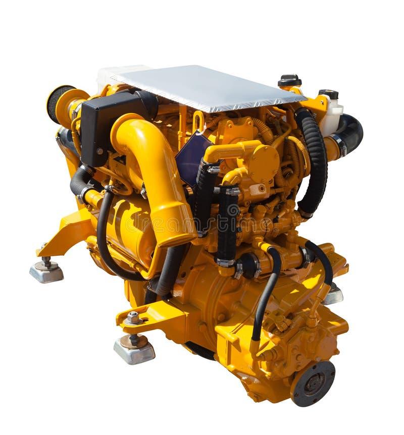 Nuevo motor amarillo. Aislado sobre blanco fotografía de archivo libre de regalías