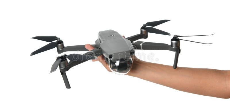 Nuevo quadcopter gris oscuro del abejón con la cámara digital y los sensores que vuelan en blanco fotos de archivo libres de regalías