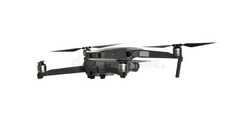 Nuevo quadcopter gris oscuro del abejón con la cámara digital y los sensores que vuelan en blanco fotografía de archivo libre de regalías