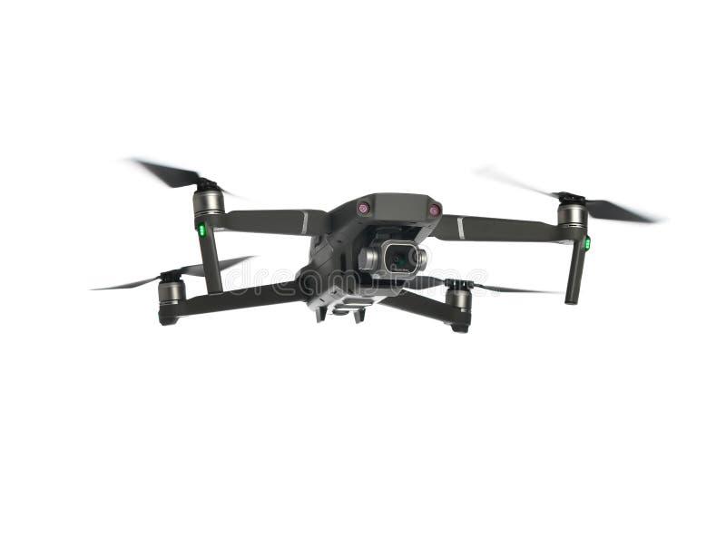 Nuevo quadcopter gris oscuro del abejón con volar de la cámara digital y de los sensores aislado en blanco imágenes de archivo libres de regalías