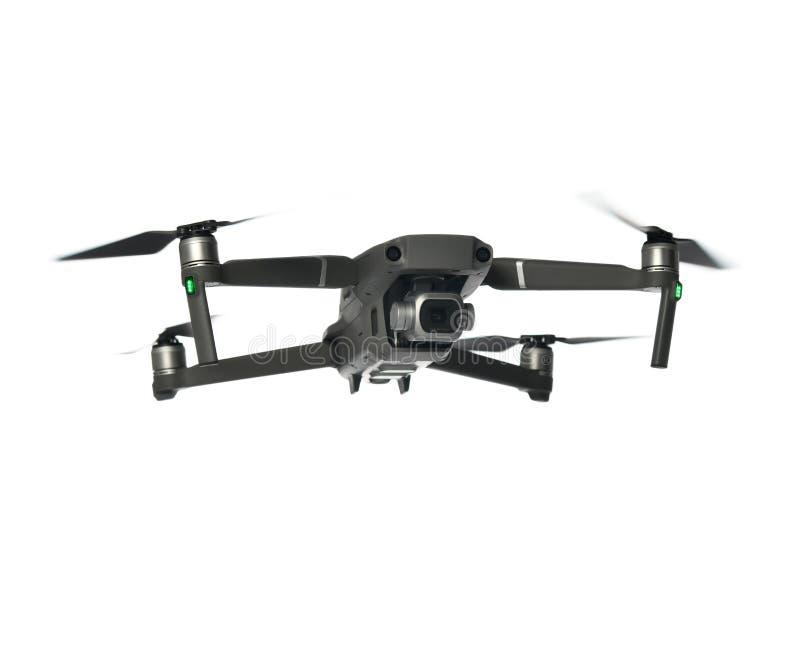Nuevo quadcopter gris oscuro del abejón con volar de la cámara digital y de los sensores aislado en blanco fotos de archivo libres de regalías