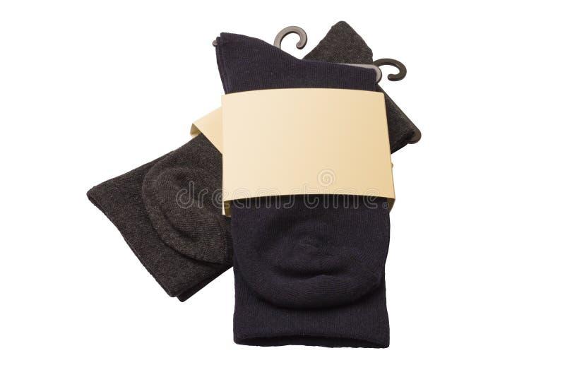 Nuevos calcetines en un fondo blanco Calcetines oscuros imágenes de archivo libres de regalías