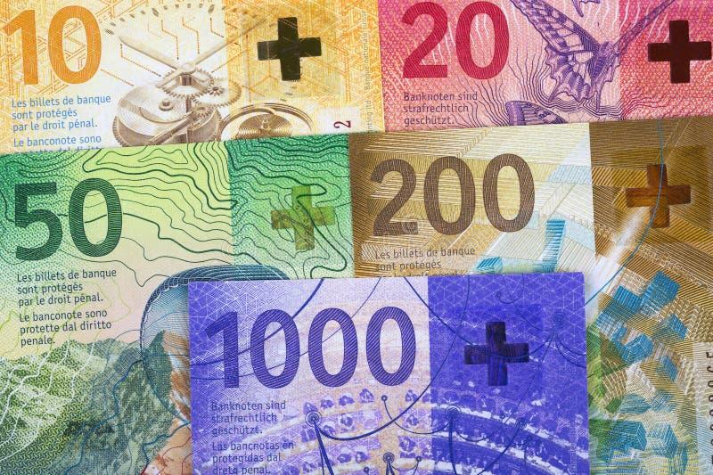 Nuevos francos suizos, un fondo del negocio imágenes de archivo libres de regalías
