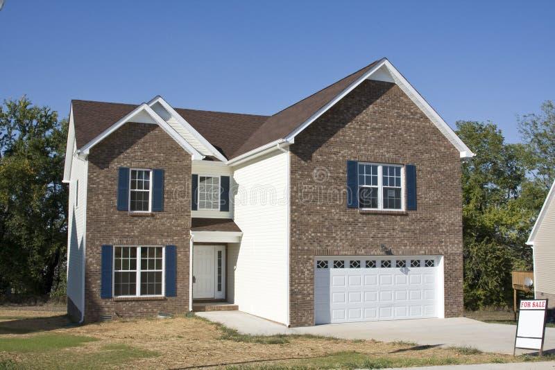 Nuevos hogares para la venta imagen de archivo