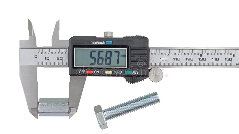 Nuez de acero grande de medición con los calibradores a vernier foto de archivo libre de regalías