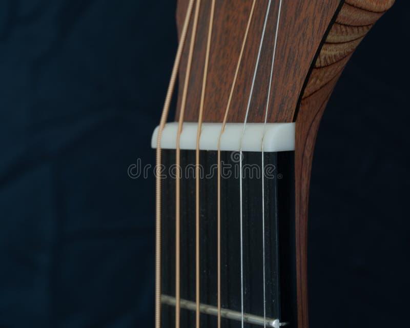 Nuez de la guitarra acústica imagen de archivo