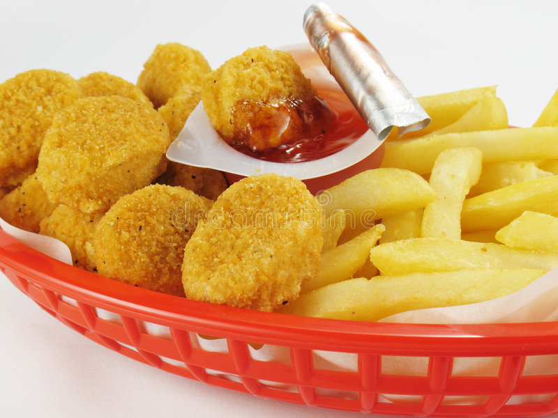 Nuggets & Fries. Basket of chicken nuggets with french fries stock photo